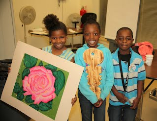 children show art in support of their incarcerated brother
